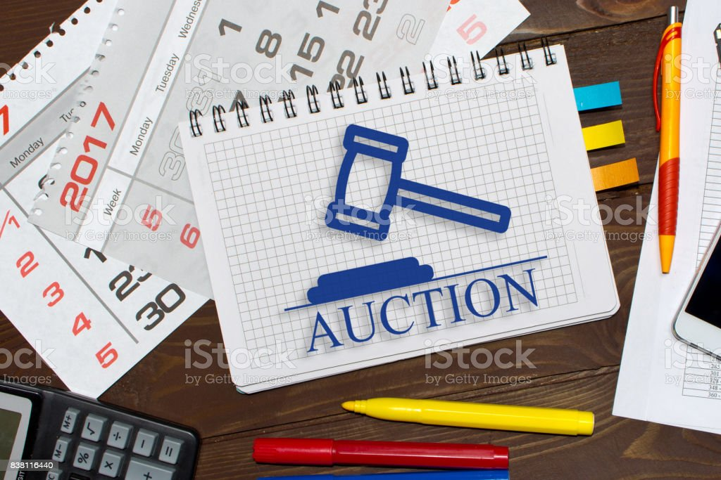 Notebook with a notes online auctions  on the office table with tools. stock photo