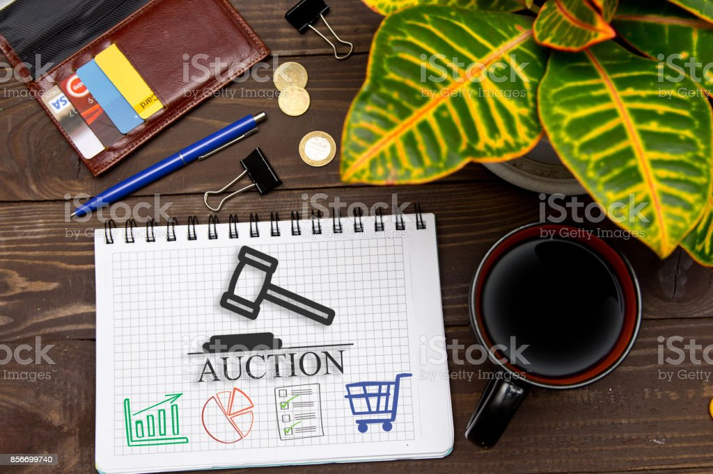 Notebook with a notes online auctions  on the office table with tools. Concept with elements of infographics. stock photo