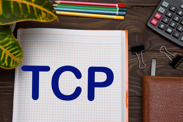 notebook with a notes tcp, transmission control protocol on the office table with tools. business concept - call center стоковые фото и изображения