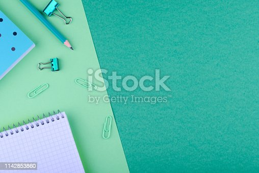 istock Notebook with a pencil on a colored background 1142853860