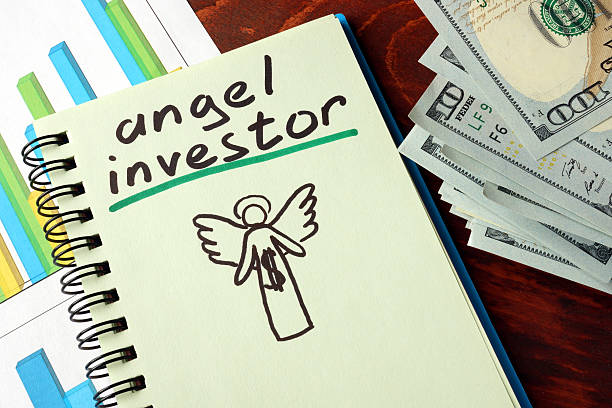 notebook with angel investor  sign.  business concept. - depositor stock pictures, royalty-free photos & images