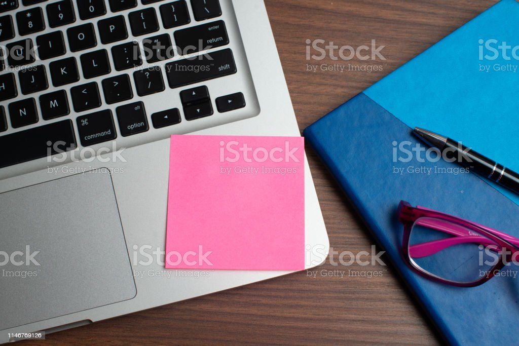 Notebook with black pen, Colorful notepads on the desk, Glasses on...