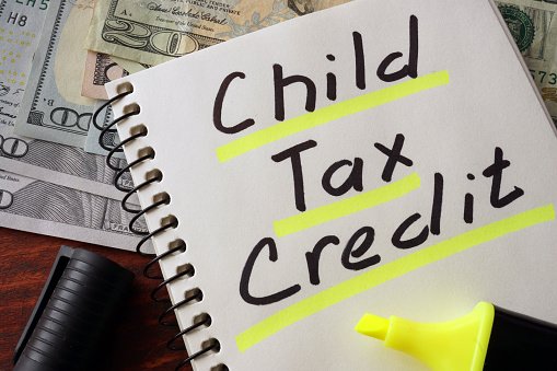 Notebook with  child tax credit sign on a table. Business concept.