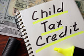 istock Notebook with child tax credit  sign on a table. 514724910