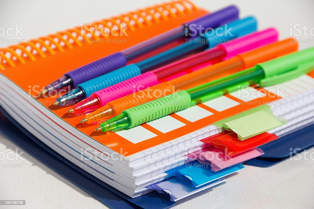 notebook with colored pens royalty-free stock photo
