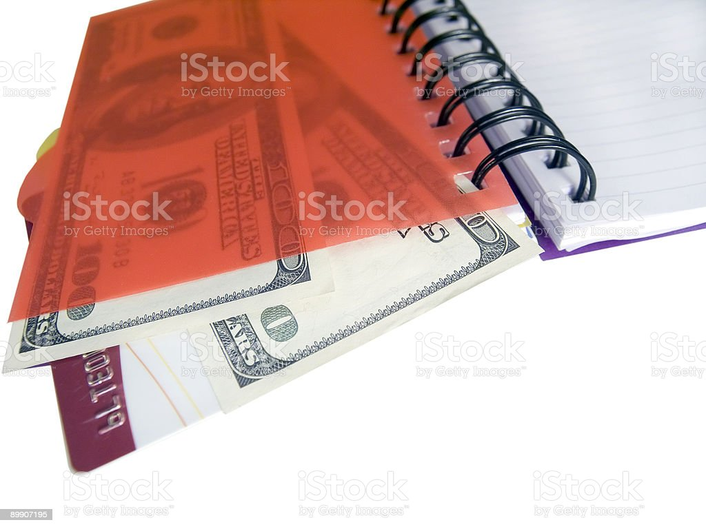 Notebook with dollars and credit card royalty-free stock photo
