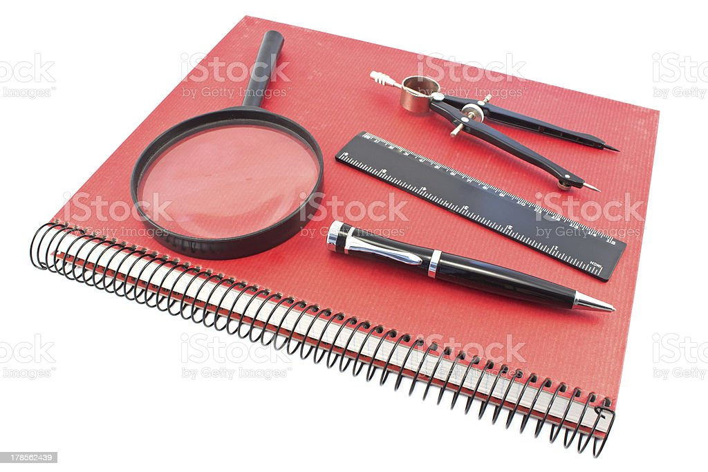 Notebook with drawing compass, ruler, pen and magnifier royalty-free stock photo