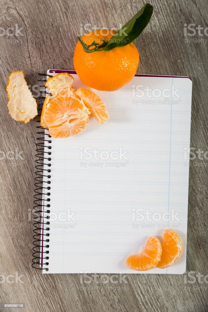 Notebook with fruit stock photo