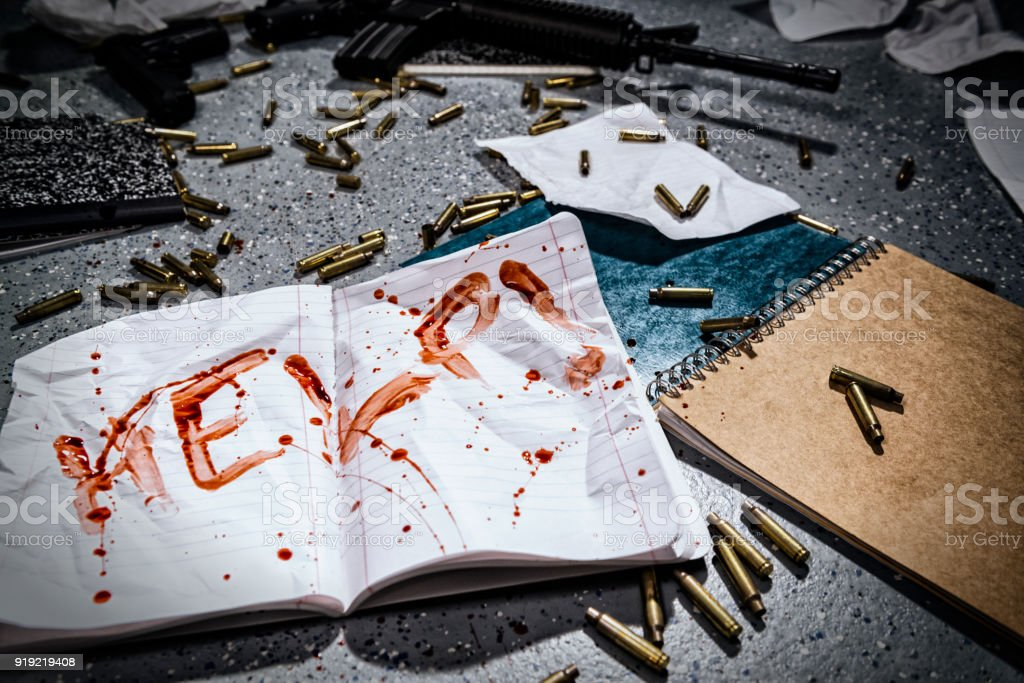 Notebook with HELP! written in blood after a school shooting in America. stock photo