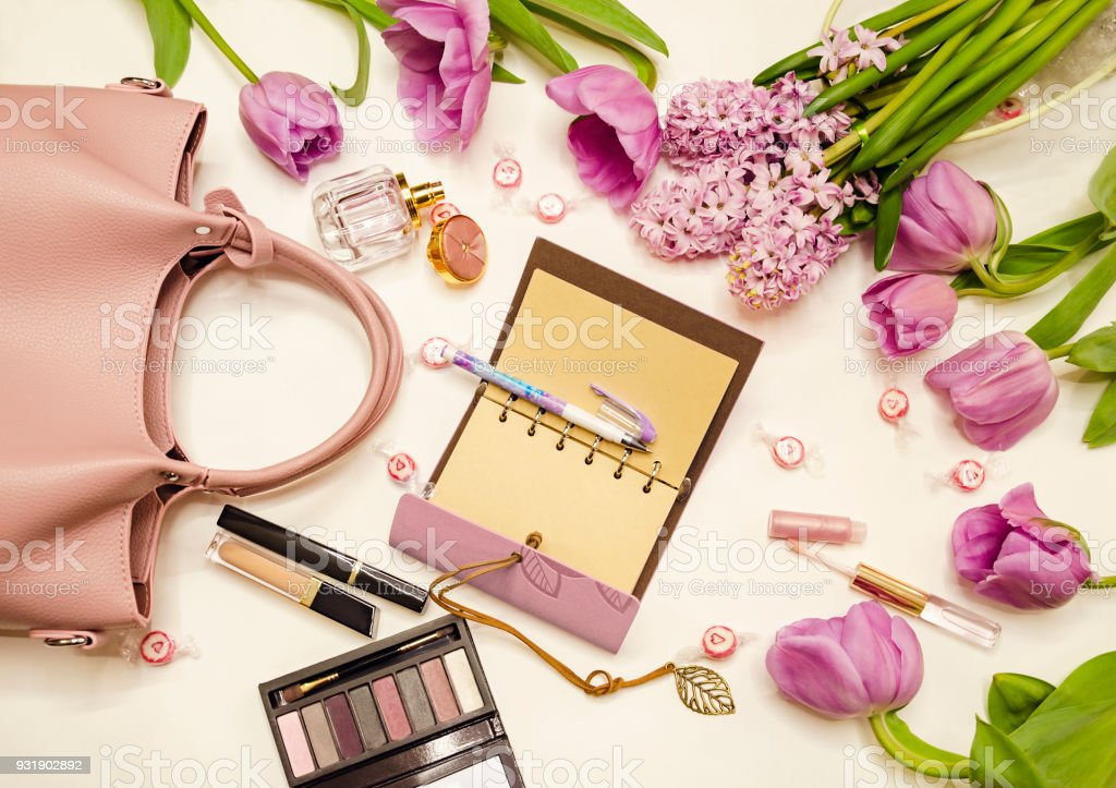 notebook with pen and flowers stock photo