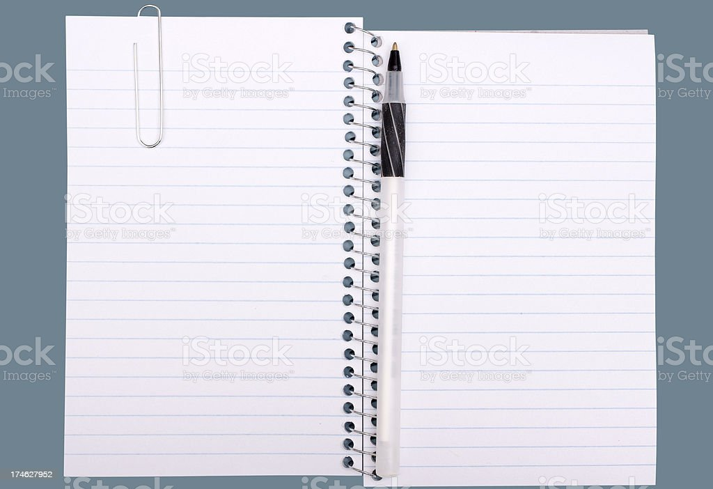 notebook with pen and paper clip royalty-free stock photo