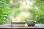 istock Notebook with pencil and cup on wooden table 585060528