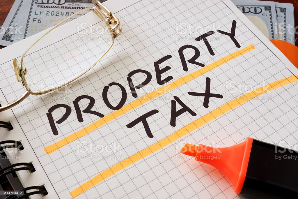Notebook with property tax sign on a table. stock photo