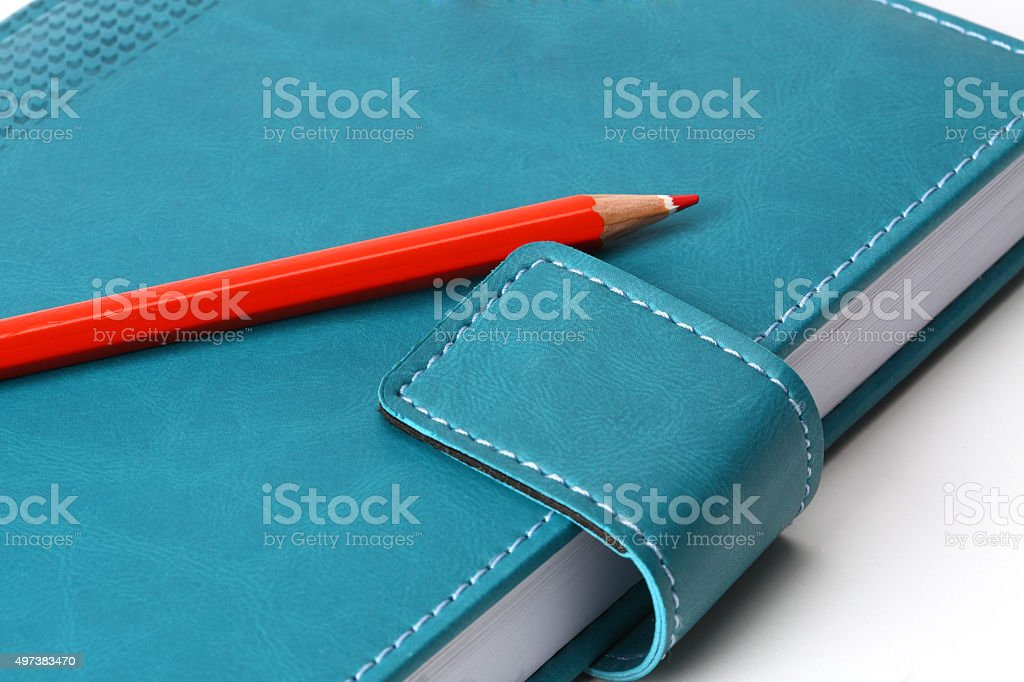 notebook  with red penci stock photo