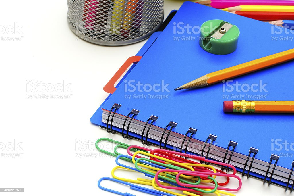 Notebook with school supplies, close up over white royalty-free stock photo