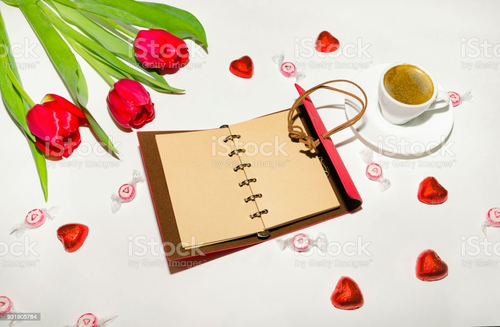 notebook with sweets and flowers stock photo