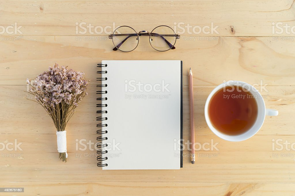 Notebook with teacup stock photo