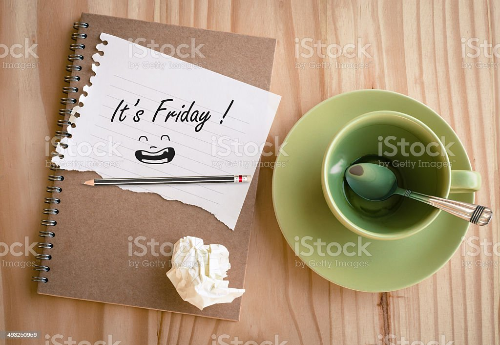Notebook with text ' It's Friday!' stock photo