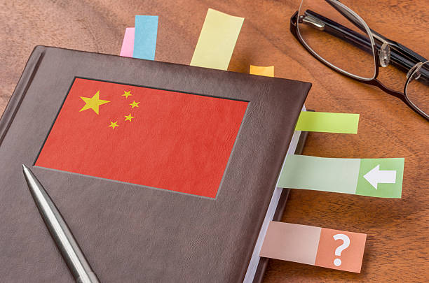 Notebook with the flag of China Notebook with the flag of China foreign affairs stock pictures, royalty-free photos & images