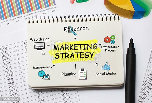 istock Notebook with Toolls and Notes about Marketing Strategy 638046690