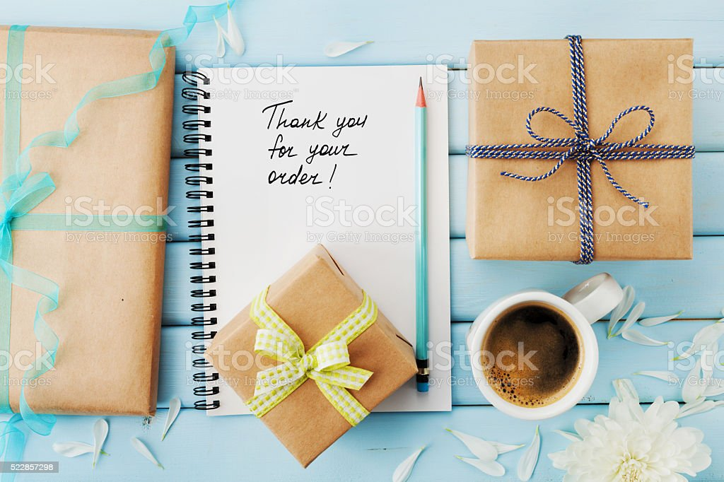 notebook with words thank you for order gifts and presents stock