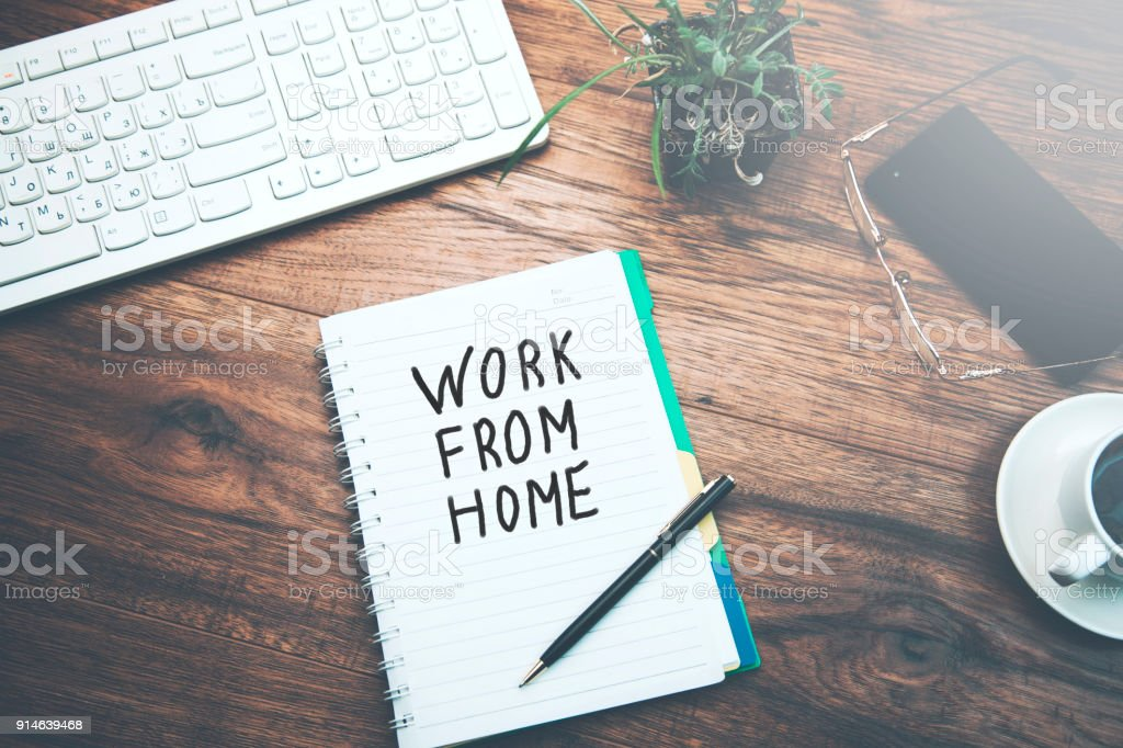 notebook  written work from home text stock photo