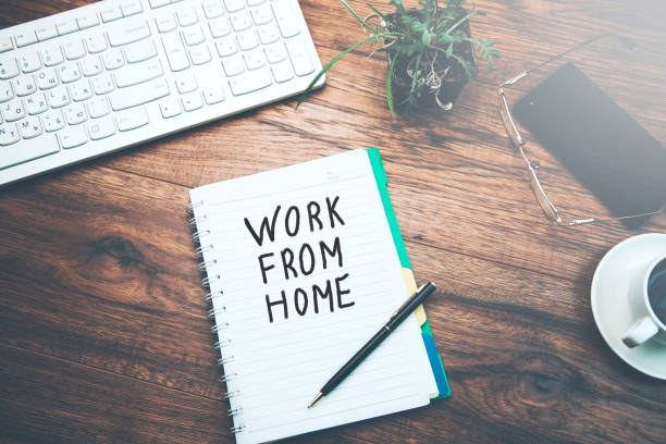 notebook  written work from home text - work from home stock pictures, royalty-free photos & images