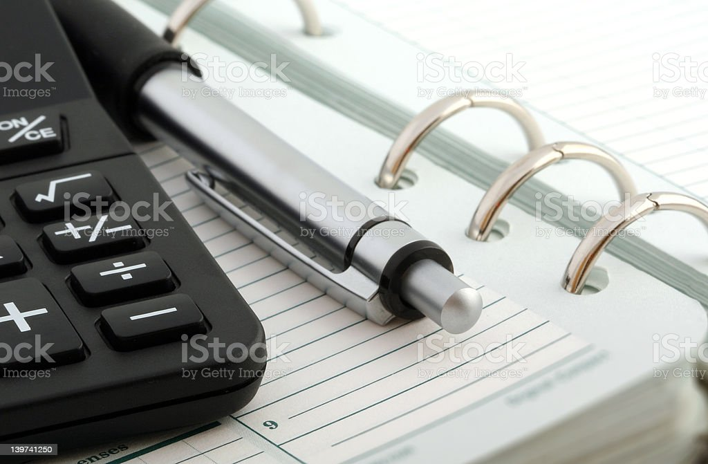 Notebook,Ballpen and Calculator royalty-free stock photo