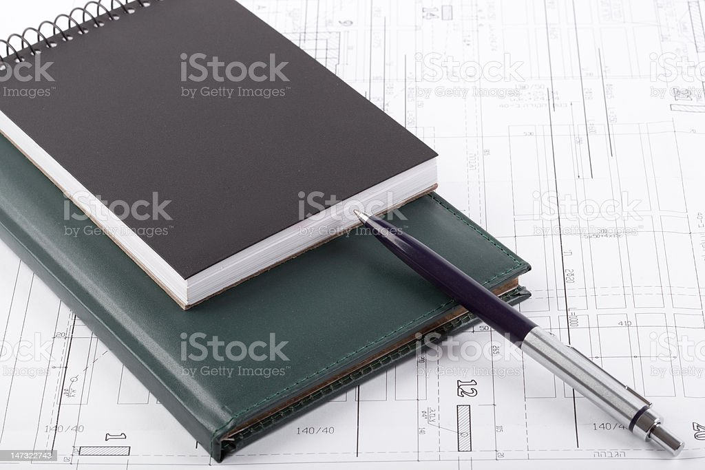 Notebooks and a pen royalty-free stock photo