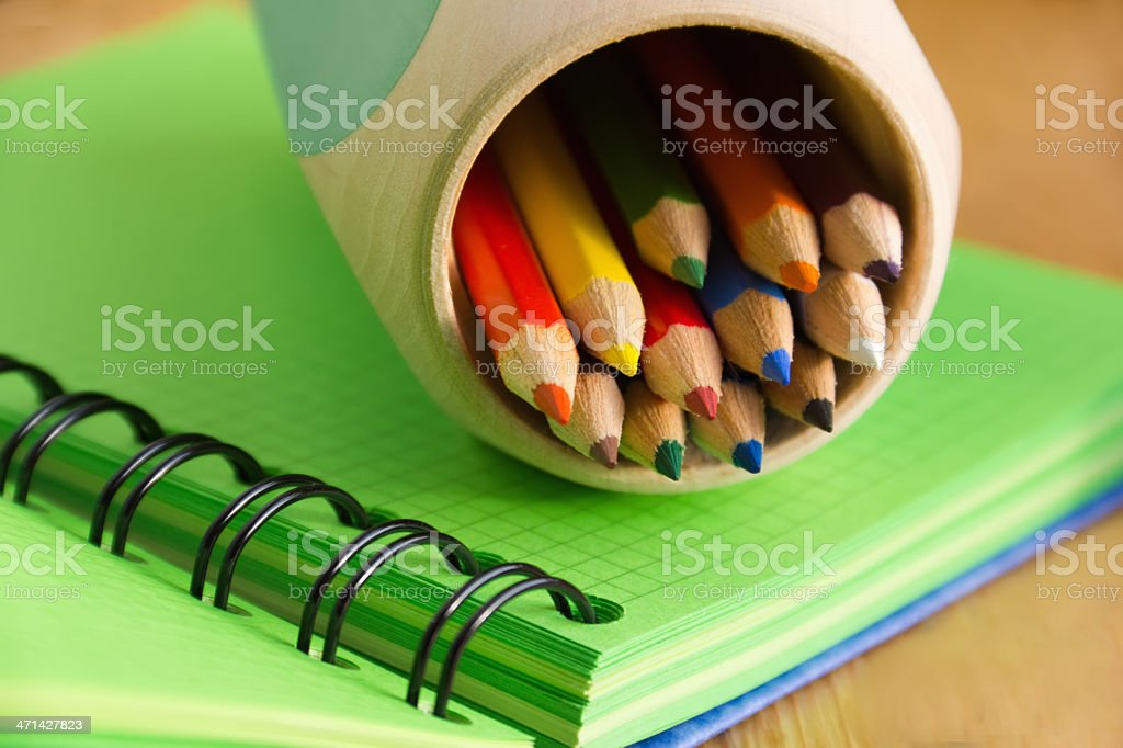 notebooks and pencil-case with colored pencils royalty-free stock photo