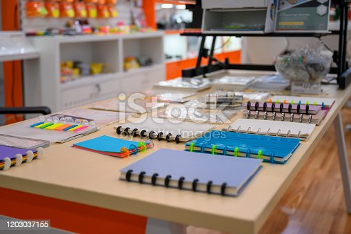 502086873 istock photo Notebooks n display in office supply store 1203037155