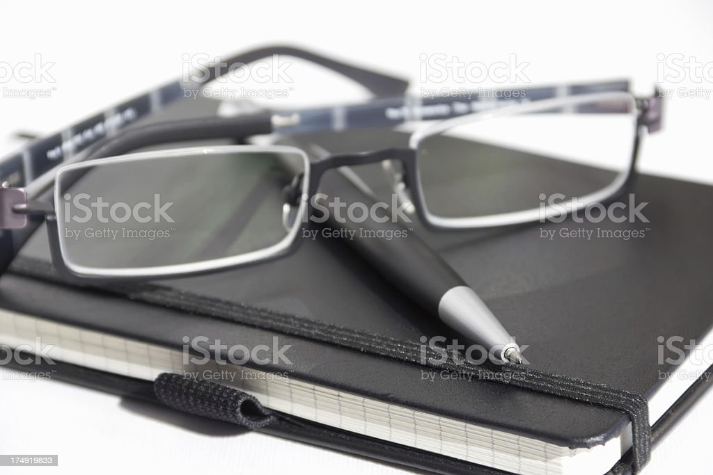notebooks with pen and glasses royalty-free stock photo