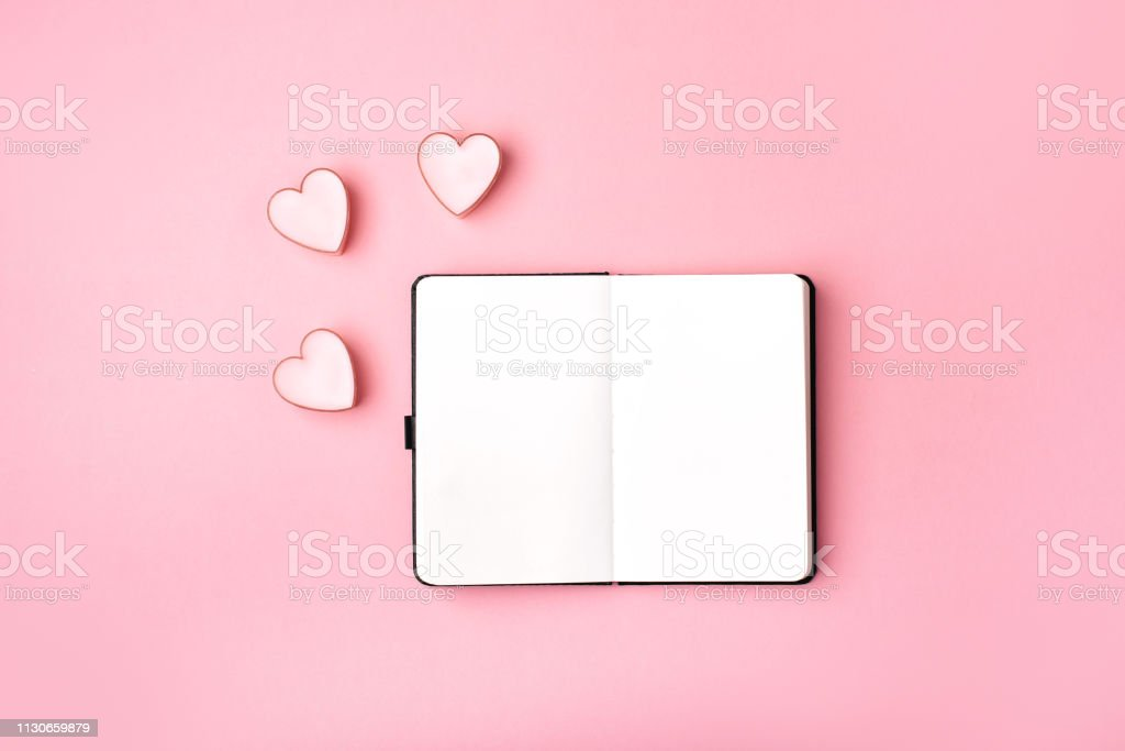Notebooks with pink paper hearts stock photo