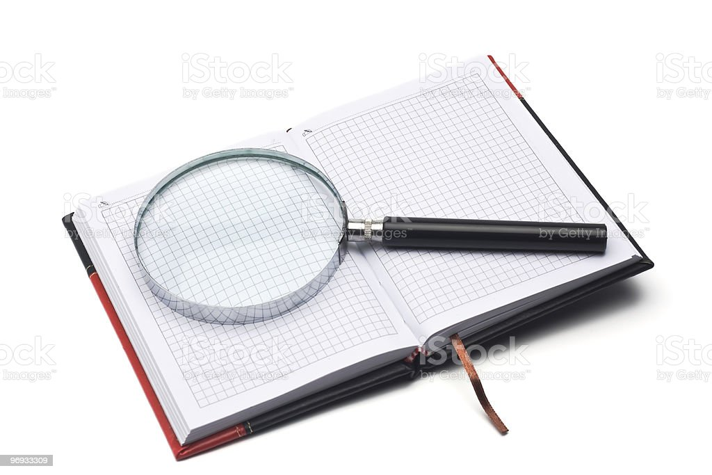 notepad and hand magnifier royalty-free stock photo
