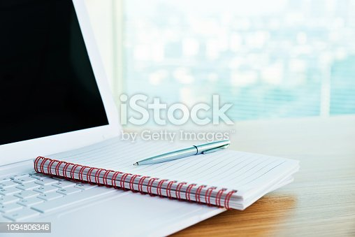 519189026 istock photo Notepad and pen on computer keyboard 1094806346