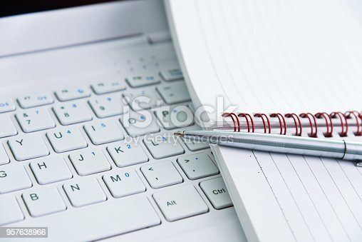 519189026 istock photo Notepad and pen on computer keyboard 957638966
