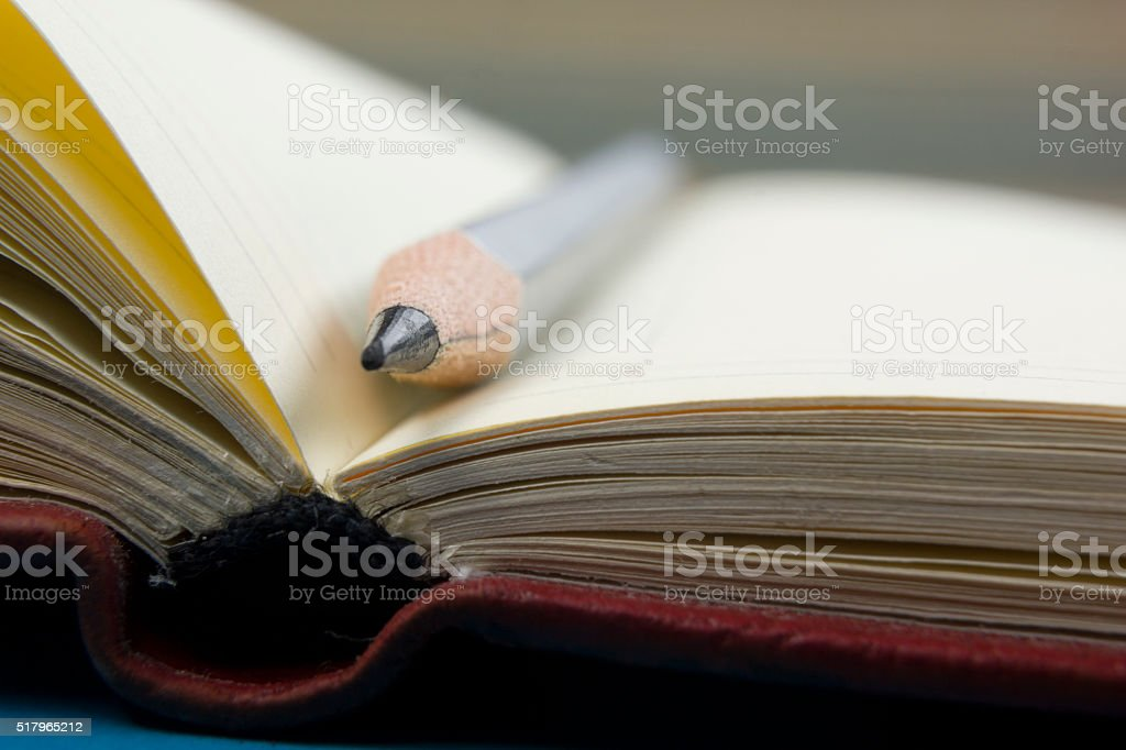 Notepad and pencil macro shot. Copy space for text - Royalty-free Backgrounds Stock Photo