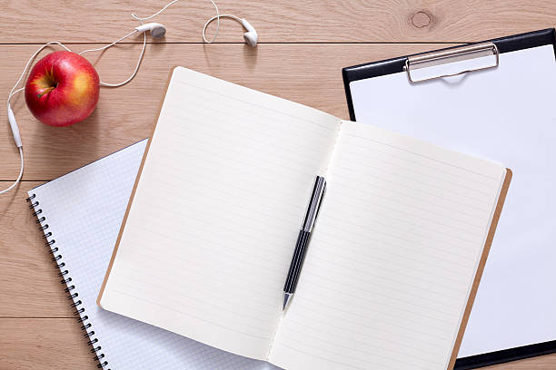 Notepad and personal diary or organizer with pen stock photo
