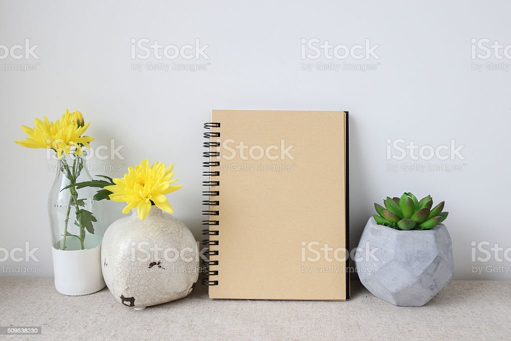 Notepad and plants pots, room interior mockup, copy space backgr stock photo