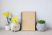 Notepad and plants pots, room interior mockup, copy space backgr