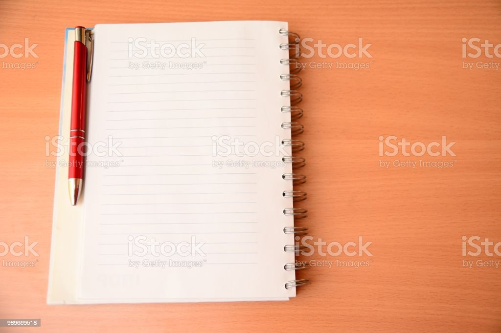 Notepad blank, and red pen on desk stock photo