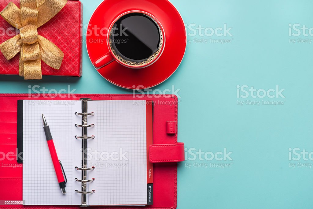 Notepad, coffee with gift boxes stock photo