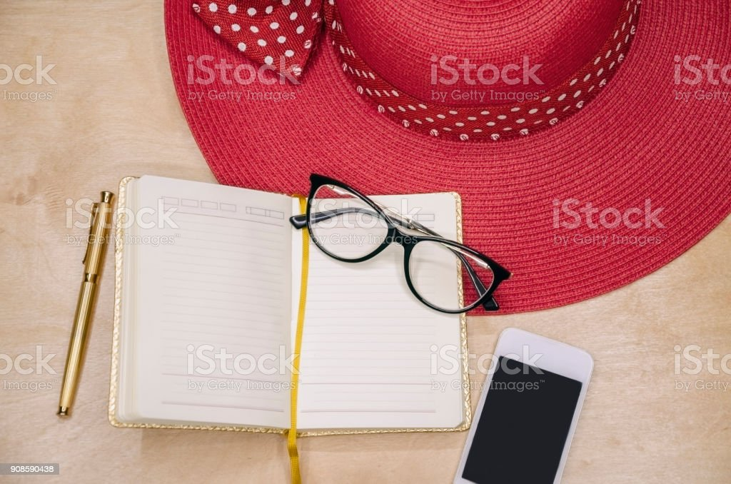 Notepad for entries with pen and phone stock photo