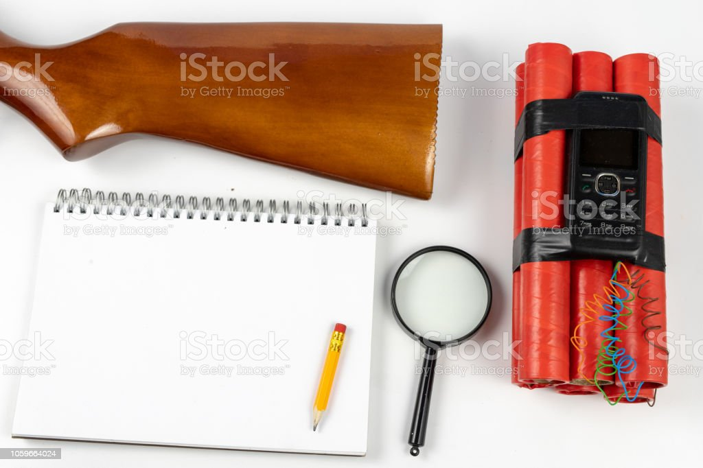 A notepad for making notes and a pencil on a table with a firearm. Shooting accessories and materials for quotation. White background. – zdjęcie