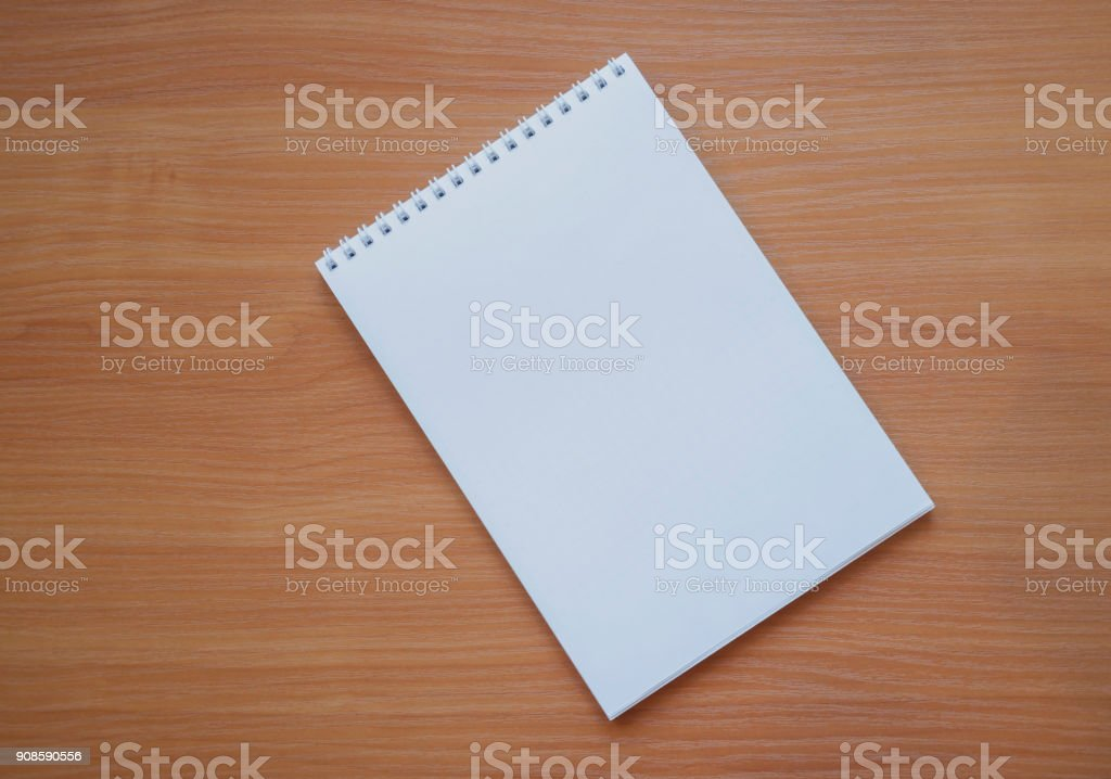 notepad for notes on a wooden background stock photo