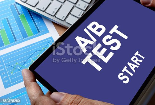 istock Notepad in hands with message A/B test. 682578280
