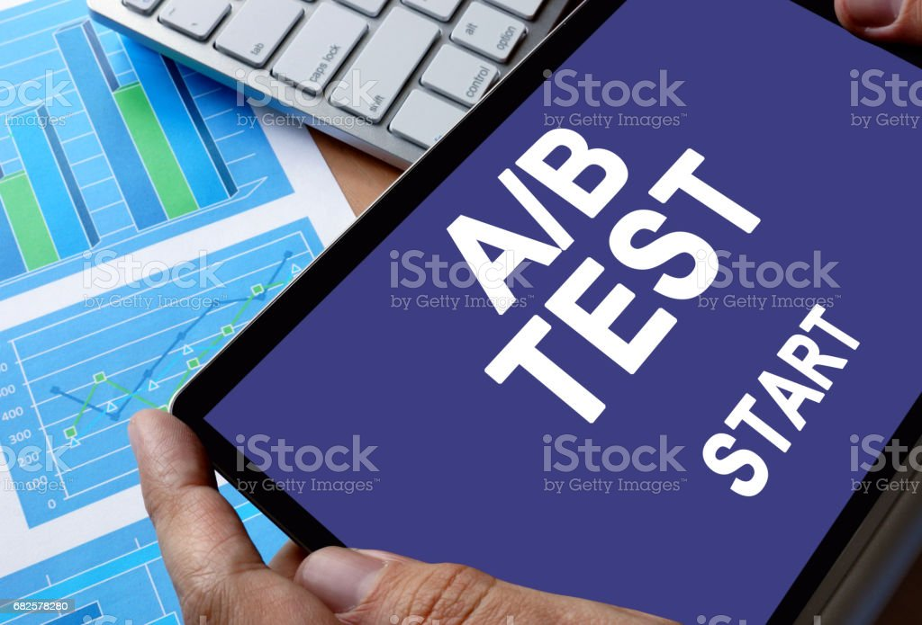Notepad in hands with message A/B test. stock photo