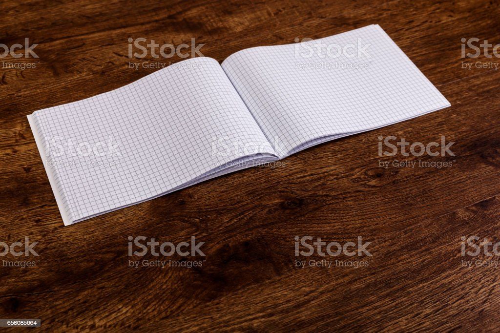 Notepad on the wooden rustic desk. Mockup. royalty-free stock photo