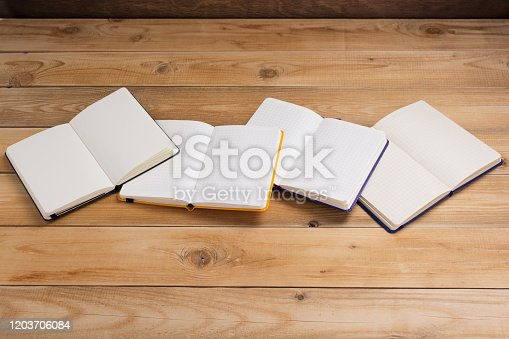 istock notepad or paper notebook at wooden table 1203706084