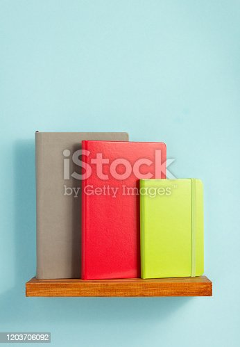 istock notepad or paper notebook at wooden table 1203706092